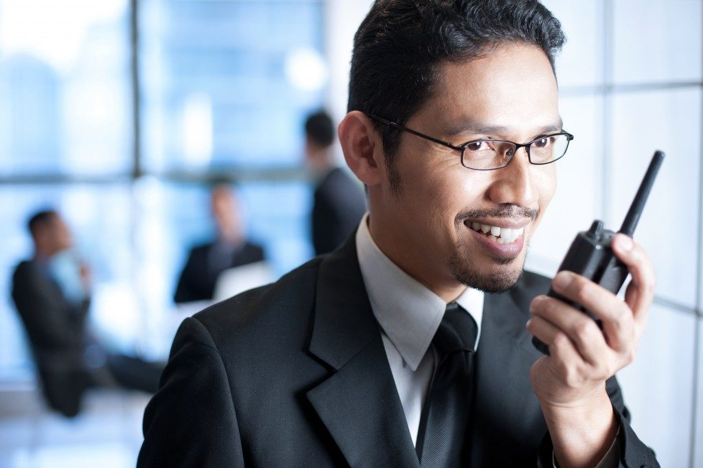 Businessman talking on a walkie talkie
