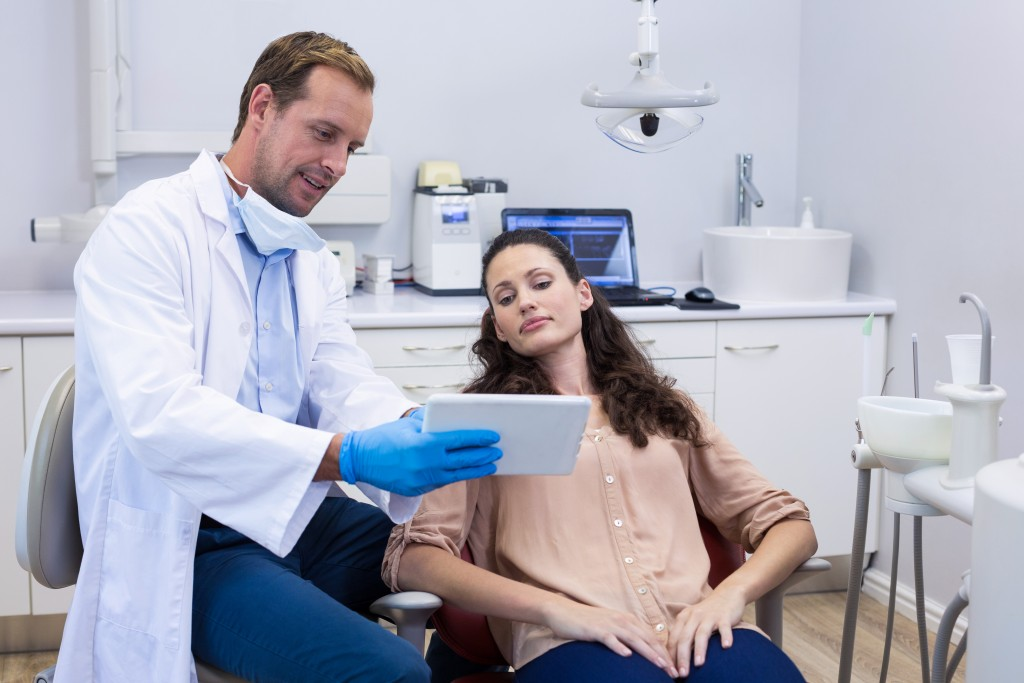 Dentist discussing using a tablet