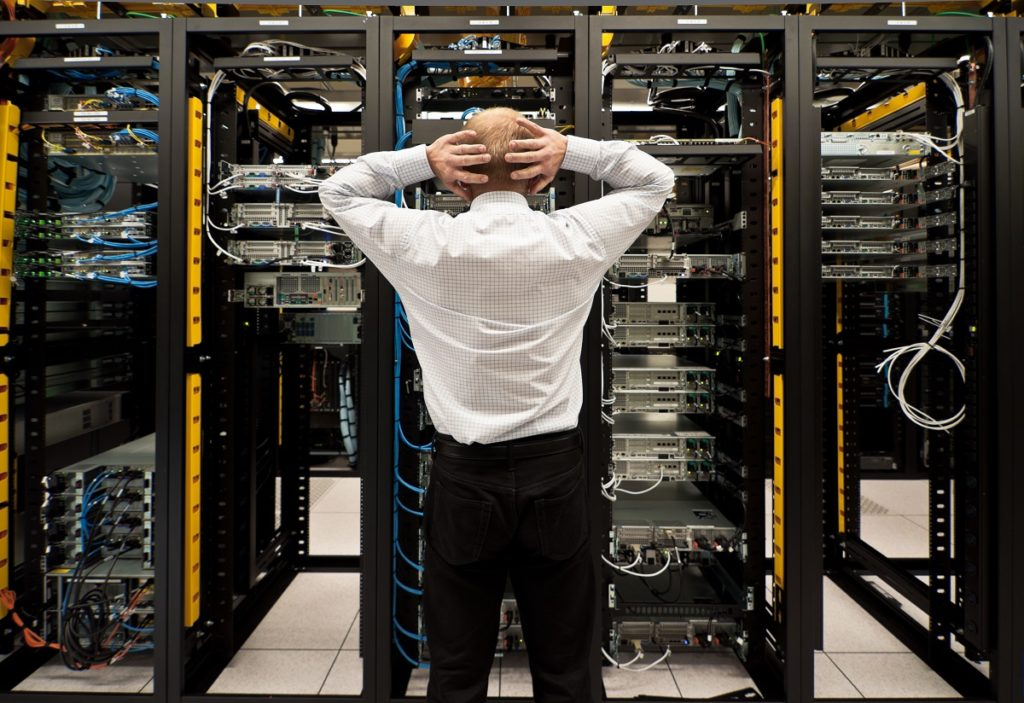 Frustrated employee looking at the network server
