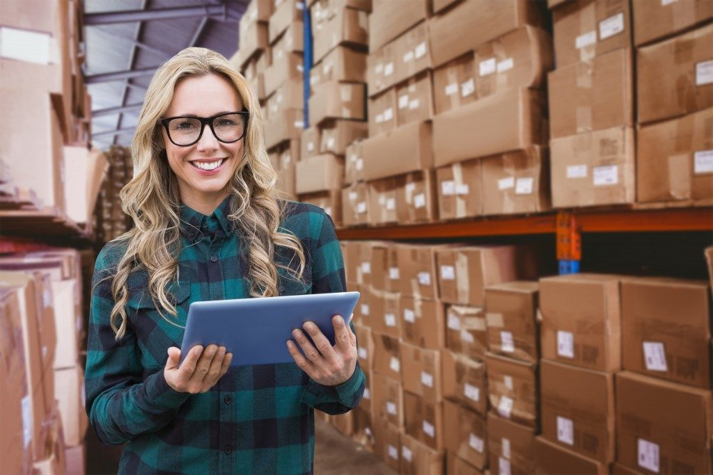 Woman holding a tablet in the warehouse