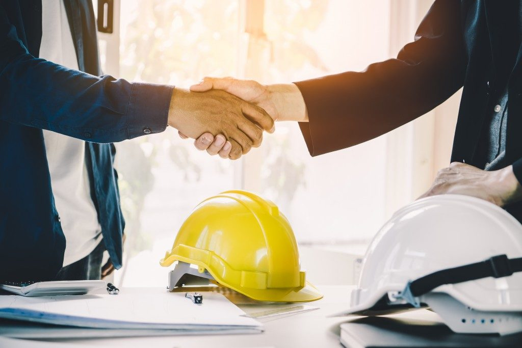 businessman shaking hands with contractor