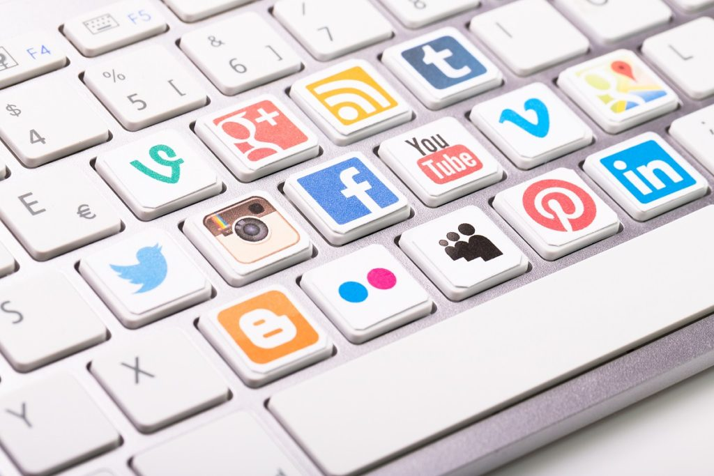 social media icons shown in the keyboards of a computer